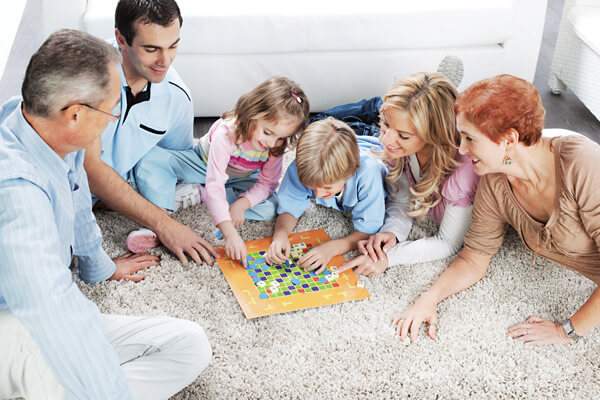 Happy multi-generation family lying on the floor at home and enjoying while playing a game together.   [url=http://www.istockphoto.com/search/lightbox/9786778][img]http://dl.dropbox.com/u/40117171/family.jpg[/img][/url]